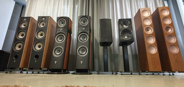Different kinds of subwoofers and speakers possibly connecting and wired to soundbars
